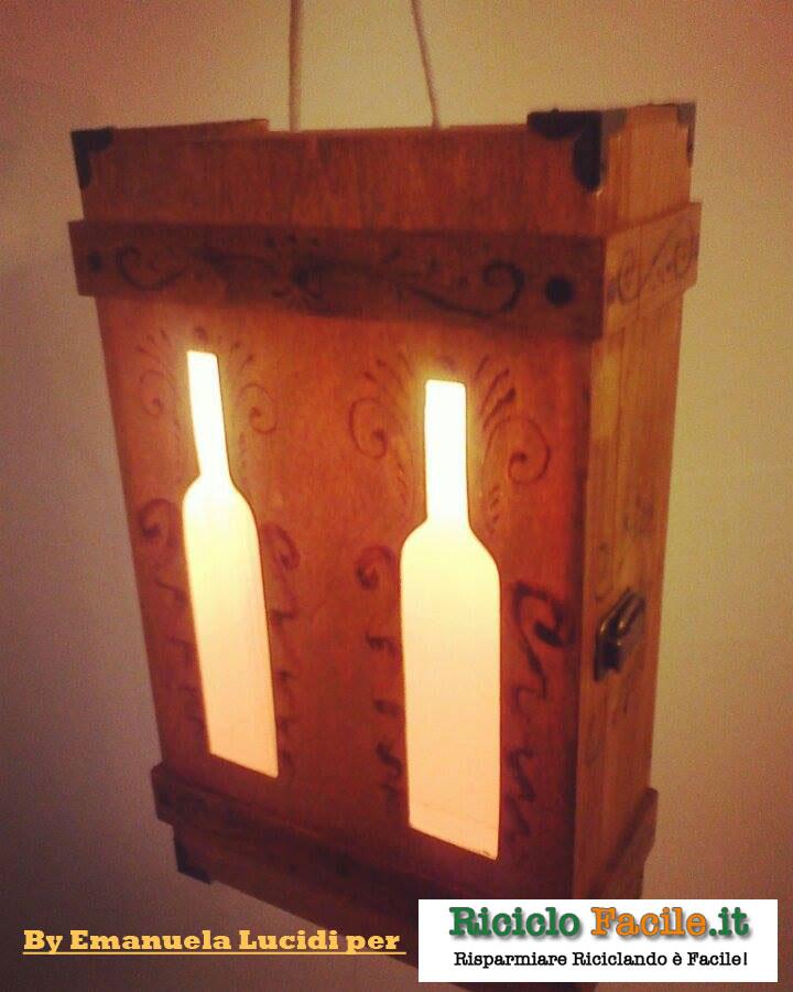 Cassetta per vino in legno trasformata in lampadario